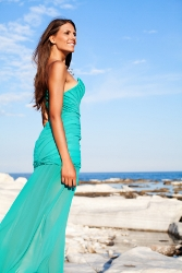 Beauty posing on the rocky coast